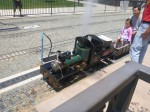 Real miniature steam engine hissing and smoking